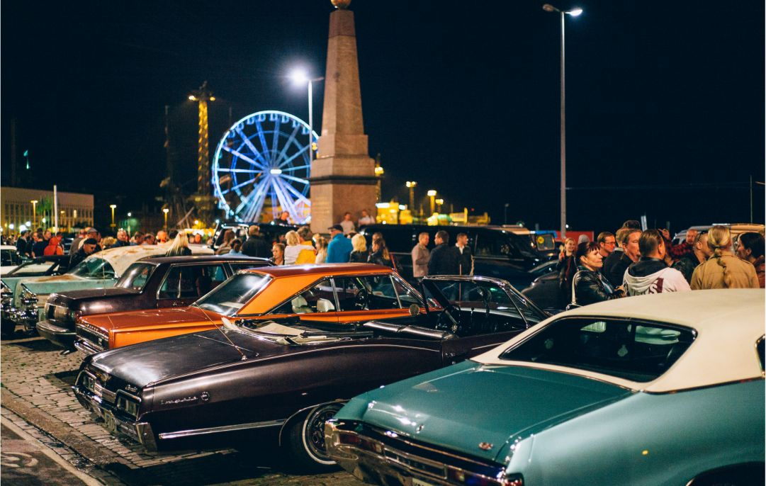 Vintage American muscle cars at night.